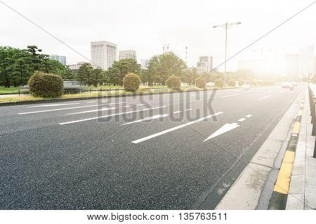 traffic on city street in morning in tokyo japan