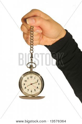 A photo of a woman holding a watch