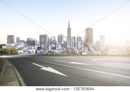 empty asphalt road with cityscape and skyline of san francisco at sunrise