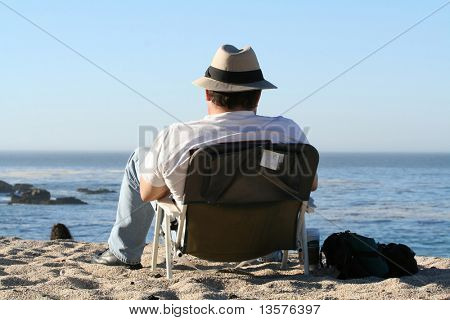 A photo of a man lounging at the beach