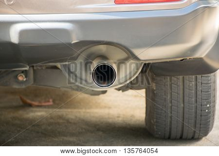 Exhaust pipe of a Brown car concern about environment