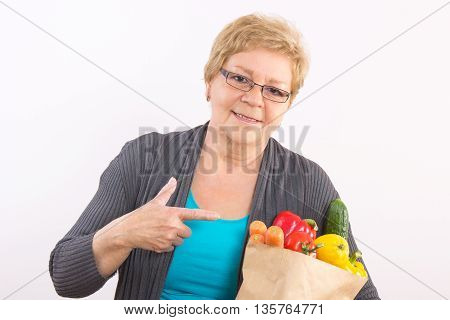 Happy Senior Woman Showing Shopping Bag With Fruits And Vegetables, Healthy Nutrition In Old Age