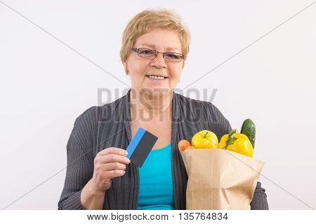 Senior Woman Holding Shopping Bag And Credit Card, Paying For Shopping
