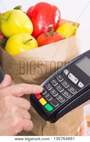 Hand Of Senior Woman Using Payment Terminal, Enter Personal Identification Number