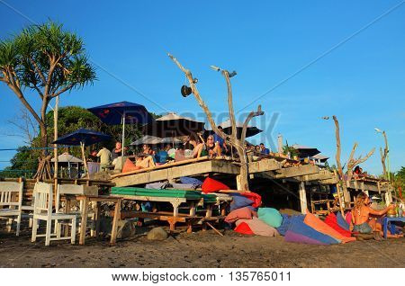 BALI INDONESIA - JUNE 23: Western tourists and expatriates relax eat and drink at a beachside bar and restaurant on June 23 2016 at Batu Belig Beach in Canggu Bali Indonesia.