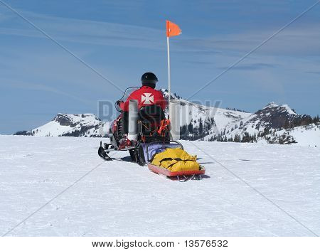 A photo of a snowmobile coming to the rescue