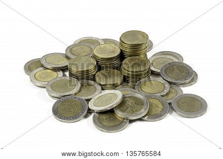 Uk pound coins stacked on white background with a reflection