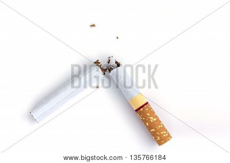 Quit smoking closeup broken cigarette on white background soft focus