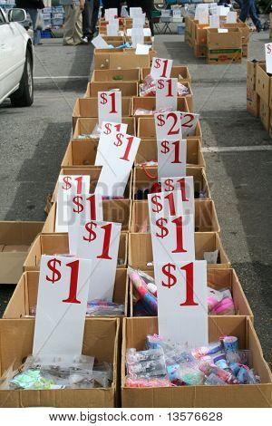 A photo of cheap items at a flea market