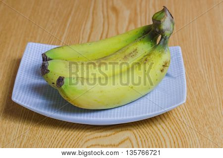 Delicious three banana on wooden background,Healthy food,Diet concept