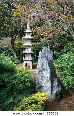A photo of a stone temple in a Japanese garden