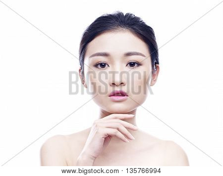 studio portrait of a young asian woman looking at camera hand on chin frontal view isolated on white.