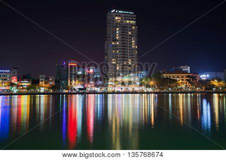 DA NANG, VIETNAM - JANUARY 05, 2016: River embankment in modern Da Nang, night illumination. Tourist landmark of the Da Nang, Vietnam