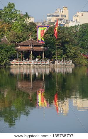 HANOI, VIETNAM - DECEMBER 13, 2015: The temple of the jade mountain on Hoan Kiem lake on a sunny day. Religious landmark  of the city Hanoi, Vietnam