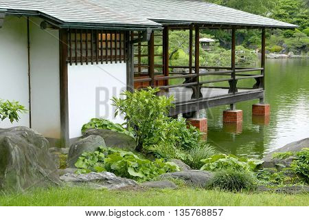 Japanese Traditional Pavilion Building And Water Pond