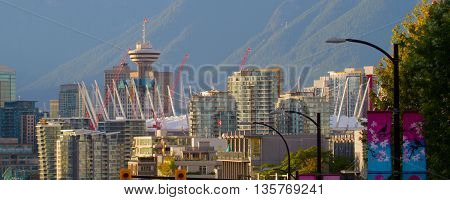 A panorama of buildings in Vancouver.  The tallest tower is called the Harbour Center.