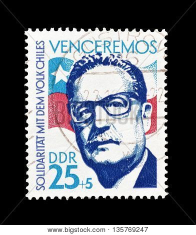 GERMAN DEMOCRATIC REPUBLIC - CIRCA 1973 : Cancelled postage stamp printed by German Democratic Republic, that shows  Salvador Allende and Chilean flag.