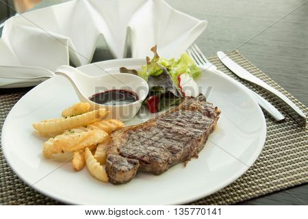 Sirloin steak with Vegetables on the plate