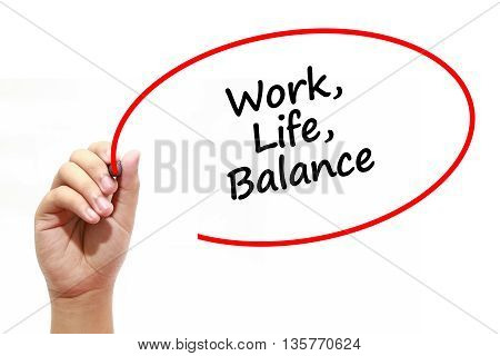 Man writing Work Life Balance with marker on transparent wipe board.
