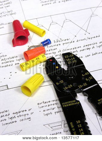 A photo of wire joiners/caps and a wire stripper with an electrician theme