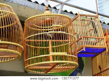 traditional handmade bamboo bird cages hanging at Songkhla pet shop, Thailand