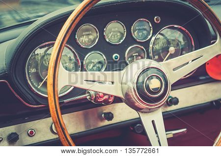 Inside of a luxury vintage car with cross process effect