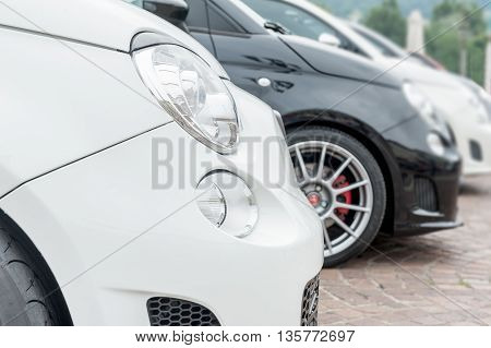 Front of city cars in a row