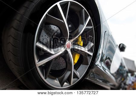 Close up of a tire of a black car