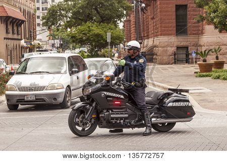 SAN ANTONIO TX USA - APR 11: Sheriff on Honda Goldwing motorcycle in the city of San Antonio. April 8 2016 in Dallas Texas United States
