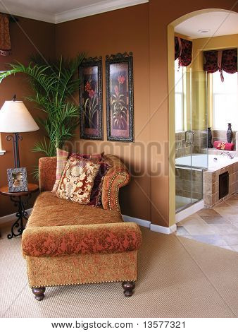 A photo of a nicely decorated master bedroom and bathroom