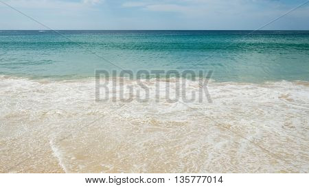 Rippling water surface of sea. Sea waves with white foam background wallpaper. Surface of wave in the blue tone color from ocean.