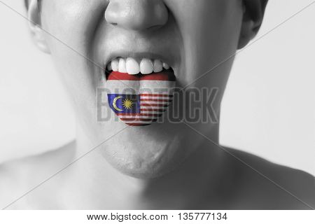 Malaysia And Indonesia Flag Painted In Tongue Of A Man - Indicating