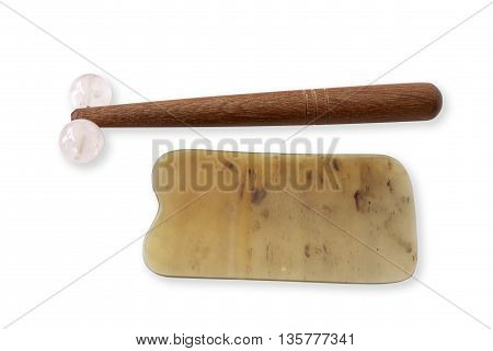 Gua sha Massage Rose Quartz and he yak plate Chinese medical traditional tool Guasha. Believe Skin Detoxification and more beauty. Isolated on white and objects with clipping paths