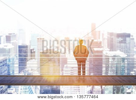 Business risk and research concept with back view of businessman standing on suspended bridge above New York city and looking into the distance. Side view. Toned image 3D Rendering