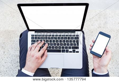 Man With Laptop And Smartphone