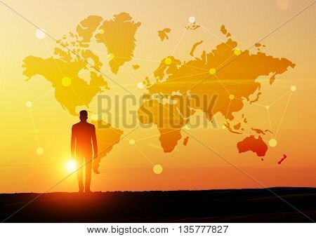 Global network concept with businessman looking at abstract map with network at sunset
