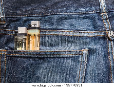 Jeans texture Blue denim jeans with cigarette lighter (focus on cigarette lighter)