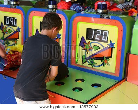 Boy playing the whack a mole game