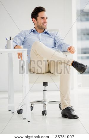 Businessman sitting at his desk in the office