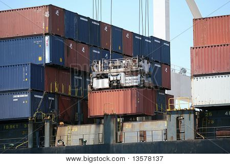 Crane picking up cargo container