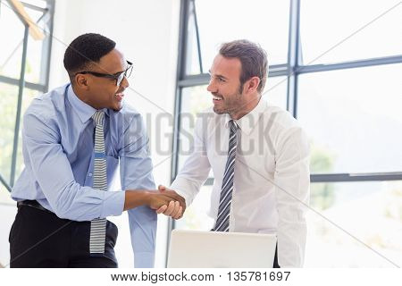 Businessmen shaking hands at a meeting in office