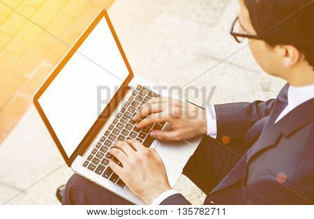 Man Using Laptop Side