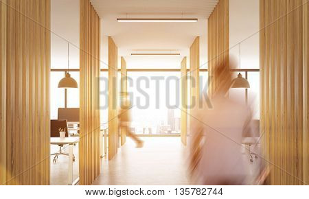 Blurry businesspeople walking in open office interior with wooden partitions concrete floor ceiling with lamps and New York city view.Toned image 3D Rendering