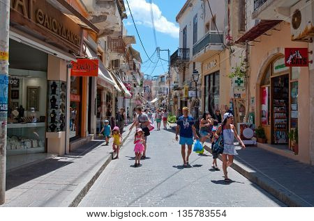 RETHYMNON CRETE-JULY 23: Shopping Arkadiou street on July 23 2014 in Rethymnon city on the island of Crete in Greece. Arkadiou Street is one of the most important shopping centres in Rethymnon
