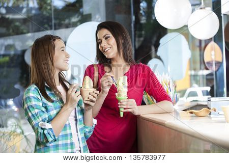 Happy Mother And Daughter Having Ice Creams