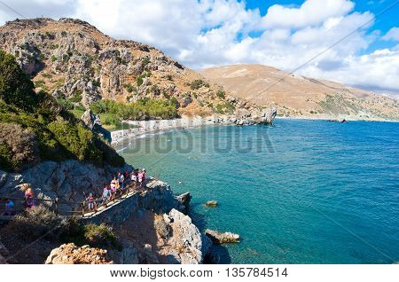 CRETEGREECE-JULY 23:Narrow path to the Preveli Beach on July 232014 on Crete Greece. The beach of Preveli is situated 40 km south of the main town and is the most idyllic beach in Crete.