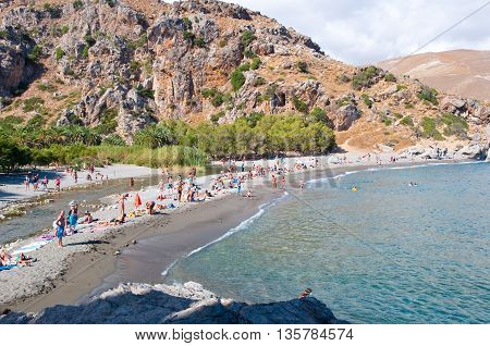 CRETEGREECE-JULY 23:Tourists on the Preveli Beach on July 232014 on Crete Greece. The beach of Preveli is situated 40 km south of the main town and is the most idyllic beach in Crete.