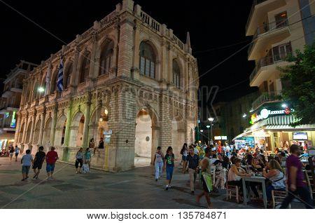 CRETE HERAKLION-JULY 24: Nightlife on Lions Square on July 24 2014 on the Crete island Greece. Lions Square is a square in the city of Heraklion in Crete.