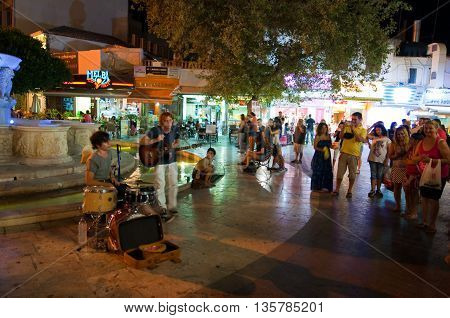 CRETEHERAKLION-JULY 24: Musicians perform on Lions Square on July 242014 in Heraklion on the Crete island Greece. Lions Square is a square in the city of Heraklion in Crete.