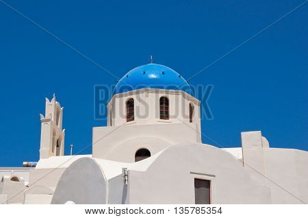 Oia church with blue cupola on the island of Santorini Greece.